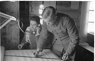 Finnish Defence Intelligence Agency - In 1944 at Rukajärvi, light and sound surveying data of Soviet artillery locations received by phone during a battle is converted onto a map and immediately relayed to friendly batteries