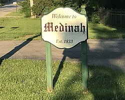 Monument sign on Illinois Route 19 welcoming drivers to Medinah