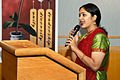 Meenakshi Ganesan describes the performance she is about to participate in to the audience as part of her presentation at Fort McCoy.jpg