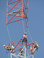 Members of the 455th Expeditionary Communications Squadron prepare to connect two tower sections as a helicopter lowers the top section into place at Bagram Airfield, Afghanistan, on Sept 120903-F-ZZ455-923.jpg