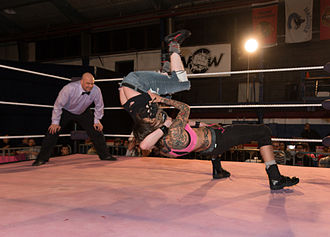 Mercedes Martinez - Martinez executing a snap suplex on Missy.