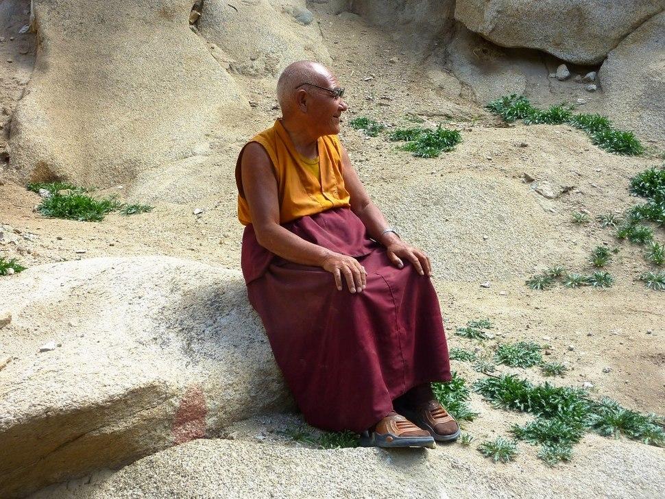 Monk resting outside Thag-Thok Gompa, Ladakh