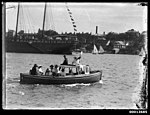 Motor launch carrying a group of spectators on Sydney Harbour (7653365052).jpg