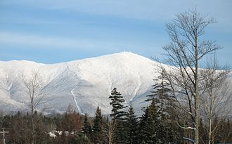 Mount Washington (New Hampshire) - Mount Washington, from Bretton Woods. The cog railway track is visible on the spur to the left of the summit.