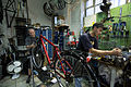 Munich - Two men working in a Bicycle repair shop - 5893.jpg