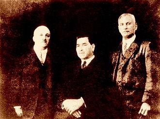N.E.B. Ezra - N.E.B. Ezra (left) with two associates