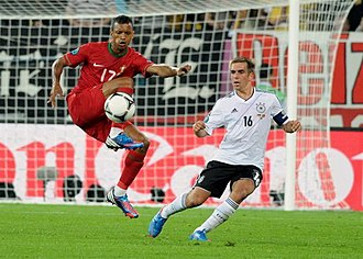 Defender (association football) - Full-back Philipp Lahm (right) marks winger Nani.