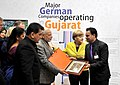Narendra Modi and the German Chancellor, Ms. Angela Merkel at the Joint Inauguration of the India Pavilion and the Joint Walk-About Make in India, in Hannover (7).jpg