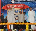 Narendra Modi waving to the gathering after laying the foundation stone for Nagpur Metro and Pardi grade separator and flyover on NH-6, in Nagpur, Maharashtra. The Governor of Maharashtra.jpg