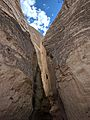 Narrow pass in Slot Canyon Trail at Tent Rocks National Monument.jpg
