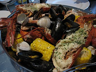 American cuisine - A New England clam bake consists of various steamed shellfish.