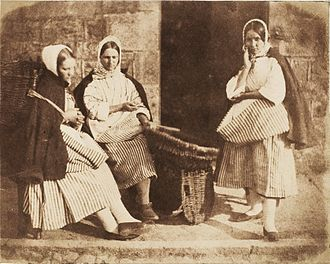 Caller Herrin' - Newhaven fishergirls pose with a creel. Photograph by Hill & Adamson, 1840s.