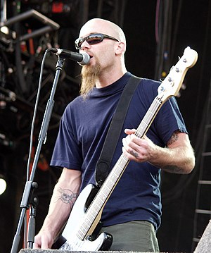 Queens of the Stone Age - Nick Oliveri, bassist 1998–2004, performing with the band at the 2003 V Festival