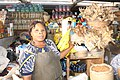 Nigerian Market woman at work waiting for customer.jpg