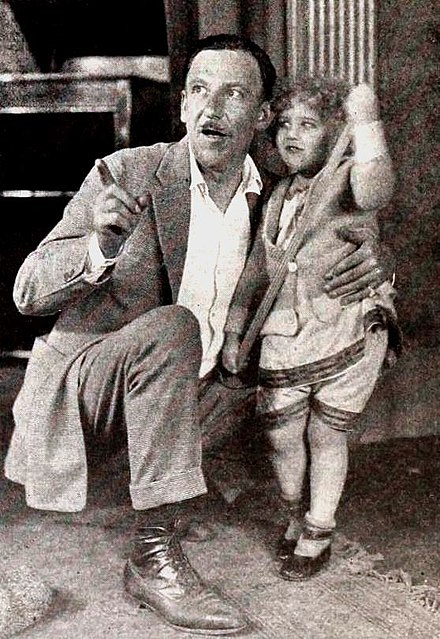 Tod Browning with unidentified child on set of No Woman Knows (1921) No Woman Knows (1921) - 12.jpg