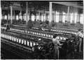 No caption. Three spinners in spinning room. - NARA - 523510.tif