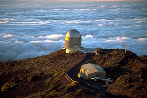 Astronomical seeing - Astronomical observatories are generally situated on mountaintops, as the air at ground level is usually more convective. A light wind bringing stable air from high above the clouds and ocean generally provides the best seeing conditions (telescope shown: NOT).