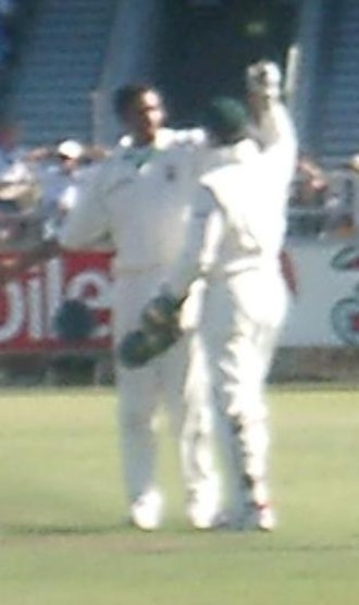 South African cricket team in Australia in 2005–06 - South African bowler Makhaya Ntini (left) celebrates
