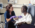 Nurse administers chemotherapy.jpg