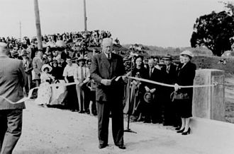 Tom Plunkett - Tom Plunkett cuts the ribbon at the official opening of the Waterford Bridge, Waterford in 1954