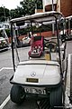 Only in HK… a golf cart with a baby seat in the front! (8120630028).jpg