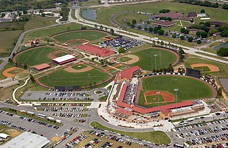 Kissimmee, Florida - Osceola County Stadium with Johnson University Florida in background