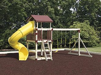 Outdoor playset - A playset on a playground, featuring a tube slide, a ladder, and swings