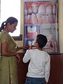 Parent and child discussing oral health in Nepal.jpg