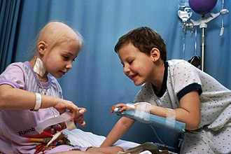 Childhood leukemia - Two girls with acute lymphocytic leukemia demonstrating intravenous access for chemotherapy.