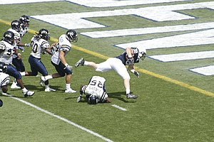 2007 Penn State Nittany Lions football team - Penn State fullback Dan Lawlor hurdles a defender to score a touchdown in the 2007 season opener.