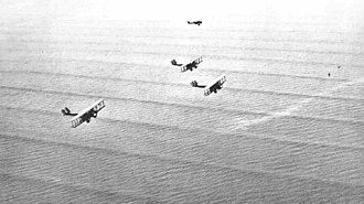Cnoidal wave - US Army bombers flying over near-periodic swell in shallow water, close to the Panama coast (1933). The sharp crests and very flat troughs are characteristic for cnoidal waves.