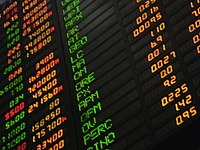 Looking up at a computerized stocks-value board at the Philippine Stock Exchange