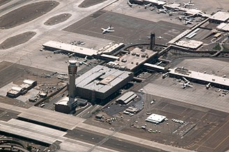 Phoenix Sky Harbor International Airport - Aerial view of the new control tower in the foreground, and the old control tower in the background, with Terminal 3 in between, looking southwest