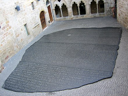 A giant copy of the Rosetta Stone by Joseph Kosuth in Figeac, France, the birthplace of Jean-Francois Champollion Place des ecritures Figeac.jpg