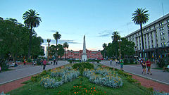 Wide angle view of Plaza de Mayo towards the Casa Rosada. The Pirámide de Mayo can be seen in the centre.