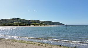 Cemaes Head - Seen from across the Teifi estuary, the headland of Cemaes Head behind Poppit Sands beach