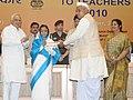 Pratibha Devisingh Patil presenting the National Award for Teacher-2010 to Shri Daya Shankar Yadav, Uttar Pradesh, on the occasion of the 'Teacher's Day', in New Delhi. The Union Minister of Human Resource Development.jpg