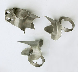 Lugged steel frame construction - Prugnat type 62 D lugs. Clockwise from top left: seat lug, upper head lug, lower head lug.