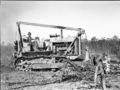 Queensland State Archives 1660 Site preparation and land clearing by bulldozer Serviceton Inala Brisbane c1950.png