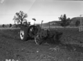 Queensland State Archives 1674 Potato digger harvesting Sebago potato crop 100120 bags to acre c1951.png
