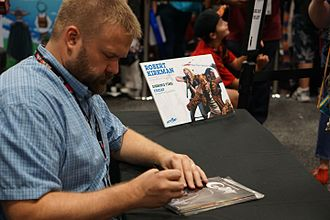 Skybound Entertainment - Robert Kirkman signing at Skybound's booth during 2016 San Diego Comic Con