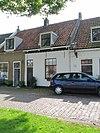 foto van Huis onder een zadeldak met het nr