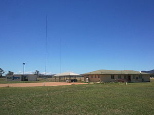 1RPH - L-R: Transmitter building, dual masts, car park and carport, studio building.