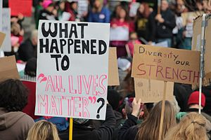 """All Lives Matter - """"What happened to 'All Lives Matter'?"""" at a protest against Donald Trump."""