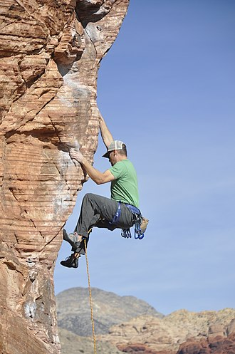 Climber climbing an arete Red Rocks - Climber on Caustic Cock, Cannibal Crag - 2.jpg