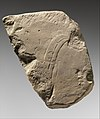 Relief fragment- foreigner with feather in his hair and Nubian MET DP311764.jpg