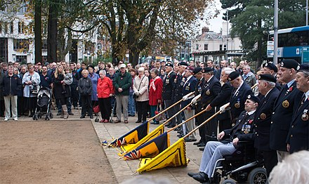 Flags lowered in salute at the Remembrance Day parade, 2011 Remembrance Day Parade, Southampton.jpg
