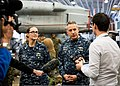Reporters interview U.S. Navy Capt. Heidi Agle, left, the acting commodore of Amphibious Squadron 11, and Capt. Daniel Dusek, the commanding officer of the amphibious assault ship USS Bonhomme Richard (LHD 6) 130730-N-UE577-003.jpg