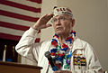 Retired U.S. Navy Capt. Jack R. Evans salutes an American flag and recites the Pledge of Allegiance during a Pearl Harbor memorial ceremony at the Veterans Museum and Memorial Center in San Diego 121207-N-JN664-033.jpg