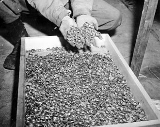 SS Main Economic and Administrative Office - US troops, while liberating Buchenwald concentration camp in 1945, found thousands of wedding rings that had been taken from victims during The Holocaust.